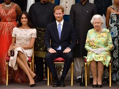 Принц Хари и Меган с кралица Елизабет Втора на прием в Бъкингам през 2018 г.