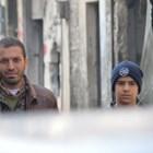 Задържаният Мохамед Абдулкадер заедно с баща си Ахмет.