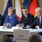 Четиримата лидери говорят на заключителната пресконференция в Париж.