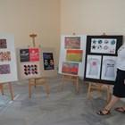 Директорката Кина Котларска пред творбите от годишната изложба на художниците