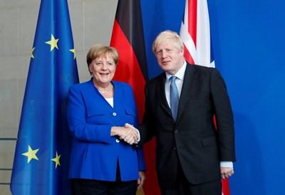 Ангела Меркел и Борис Джонсън СНИМКА: РОЙТЕРС