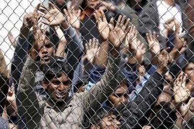 Мигранти в лагера на о. Лесбос СНИМКА: Ройтерс