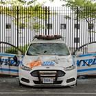 Кадри от протестите. Полицейска кола бе изрисувана. Снимки: Ройтерс