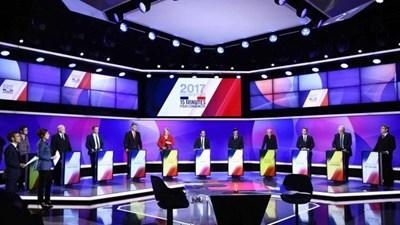 Единадесетте кандидати за френски пррезидент направиха последните си обръщения към избирателите в четвъртък вечерта по телевизията. Точно по това време ислямист уби полицай и рани други двама на Шанз Елизе. СНИМКА: РОЙТЕРС