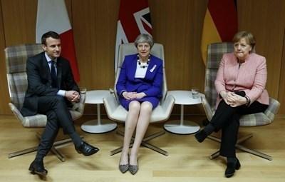 Еманюел Макрон, Тереза Мей и Ангела Меркел. Снимка: Ройтерс