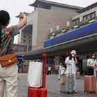 Хора с маски в Пекин СНИМКА: РОЙТЕРС