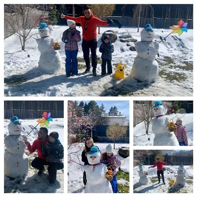 Коцето се състезава със снежни човеци