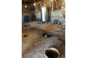 Тези отвори в пода са гърлата на заровените в земята квеври с вино.