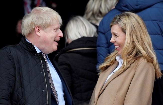 Борис Джонсън и Кари Снимка: Ройтерс