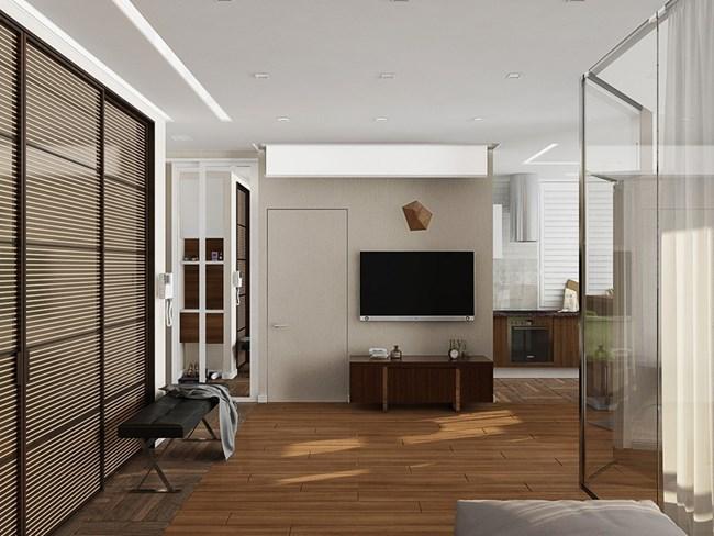 На стената срещу дивана има телевизор, но и пано за прожектиране, което превръща зоната в малка кинозала