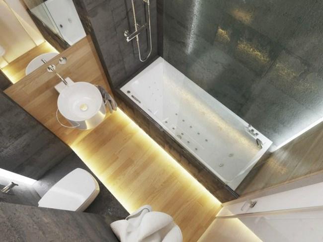 Осветлението в банята и в цялото жилище е прецизно подбрано, така че визуално да увеличава пространството