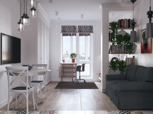 Малкото жилище е много светло, а работното място на детето е пред прозореца Снимки design-homes.ru