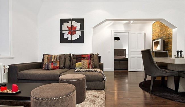 Жилището е в скандинавски стил, омекотен от топлите тонове Снимки design-homes.ru