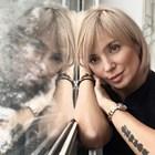 3 талисмана висят на Ирина Тенчева