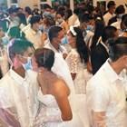 Стотици се ожениха на масова церемония с предпазни маски във Филипините